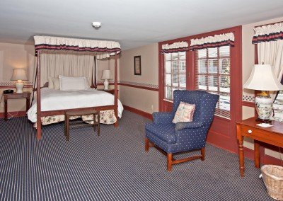 Room with four post bed and balcony